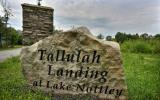 Ready to build that dream home? Begin the journey with the purchase of this gently lot in the upscale Tallulah Landing lakeside community. This gated all paved roads is perfect for your mountain cabin