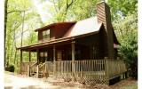 Comfortable get-away cabin in gated river access community offers peaceful forest view and is situated within walking distance of the Coosawattee River. This gently lived-in cabin-style home is perfec