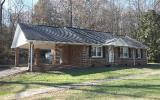 Dont let this one get away! Nice brick ranch on 10.77 acres. The interior features 3 large bedrooms, oversized living room, separate dining room and kitchen. The exterior features detached garage, out