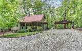 Charming rustic home less than 5 miles from downtown Ellijay. Has 3 bedrooms/2 full baths, open great room, wood burning fireplace with lots of large windows and vaulted ceiling, master has fireplace