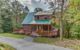 FURNISHED 2BR/2BA cabin on 3 acres, located in popular mountain community. Great room features soaring cathedral ceiling, oversize windows, wood burning stone fireplace & hardwood floors. The fully eq