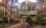 Cozy and convenient to Blue Ridge, GA. This cabin features wonderful outdoor living with a huge 25 x 25 deck plus a screened porch. Inside is a warm and inviting liiving area w/stone fplc open to dini