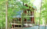 Immaculately maintained wooded cabin in the heart of Coosawattee River Resort! This 2/2 boasts a soaring stone fireplace with gas logs, a bed and bath on each level, open loft for extra sleeping space