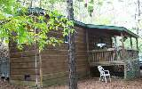 TERRIFIC GET-A-WAY CABIN AT THE COOSAWATTEE RIVER RESORT ! This cabin was built on an RV frame and has a covered front porch and screened in back porch. Your kids or grandchildren will love to sleep o