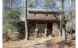 You will LOVE this darling cabin with all of the renovations and all furniture and d�cor remain with Seller approved offer! On the main is a Living Room with fireplace (gas logs/vented), Large Dining