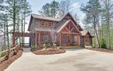 All paved roads lead to the concrete driveway and beautifully landscaped approach this magnificent Keith Sumner Custom Home with jaw dropping views of the lake like you have never seen, from each room