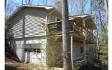 Lake Nottely Cottage on year round water!! Covered Boat dock with TVA permit. Very charming lake home with 2 bedrooms, 2 baths on main level, living room with rock fireplace and cozy gas logs. Enjoy t
