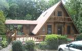 Adorable mountain retreat! 2br/1.5ba well maintained A-frame comes furnished, with branch, small pond, manicured grounds, fencing, wrap around deck and perfect covered porch overlooking pond, new roof