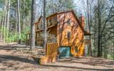 Check out this 3BR/3BA cabin perfectly situated on a gentle wooded lot across the road from Mountaintown Creek. Selling furnished, this cabin has space galore with 2468 sq ft, featuring an open great