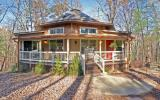 A DELIGHTFUL HOME! This comfortable cabin is situated on a premium wooded lot and you will love the setting! The home features the master bedroom on the main level, an enclosed porch where you will sp