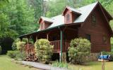 This true log cabin, with 3.43 acres, feels so private and serene, and yet is located less than one mile from downtown. The main level features Master BR and BA, Living Room, Dining, Kitchen (with isl