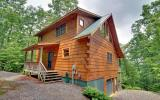 Own your log home in the mountains with privacy and convenience. Beautiful three bedroom, three bath home has the mountain feel with the trees, rustic furniture, and big porches to enjoy the privacy a