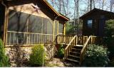This private, cozy park model cabin is located at the end of a culdesac in Crockett Ridge. Two bedrooms, one bath and a sleeping loft area for the kids/grandkids. All wood interior with hardwood floor