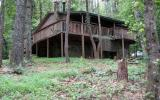 Located just across the street from Little Fightingtown Creek, this 1.45 acre property offers stunning year-round views of the Cohutta Mountains. Private, wooded location. Wraparound porch offers grea