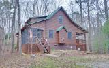 Absolutely adorable 2BR/2BA cabin in the woods! Fully furnished and ready to move into or ready to put on the vacation rental market! Excellent Condition! All wood floors, rough sawn pine cabinets wit