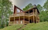 Looking for the perfect property for a rental program? You have found it! This beautifully furnished cabin minutes from downtown Blue Ridge features large bedrooms with full bathrooms on every level,