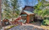 You will love this adorable chink log cabin nestled on a private wooded lot! Full of Vintage CHARM, this cabin features an open living space with floor-to-ceiling rock fireplace, fully equipped countr