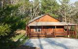 LIKE NEW! This 3/2 cabin is sparkling with its solid walnut floors and all stainless appliances. Freshly laid mulch, fresh gravel driveway, and the entire home freshly stained makes the home appear li