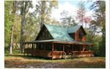 Relax in the hot tub on your wrap-around deck, and enjoy the pasture & mountain view beyond, the bubbling creek. This pristine log cabin sits on a beautiful, gentle 2 acre lot with all paved road acce