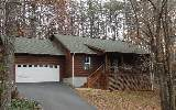 This 3/2 is in nice established residential area on wooded lot! Home has vaulted ceilings & gas log rock fireplace in the living area, nice wood floors in the living/dining/kitchen with carpeted bedro