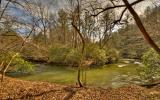 AMAZING 128.07 +/- ACRE PROPERTY WITH OVER A MILE OF ELLIJAY RIVER FRONTAGE! This ONE OF A KIND Property has an Old Home Place, Barns, Pasture, Mountain Views & River Frontage! Full of Hardwoods, Moun