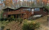 COZY CABIN IN THE WOODS. THIS HOME OFFERS LONG RANGE MOUNTAIN VIEWS, A SCREENED IN PORCH, WOOD BURNING STOVE, BASEMENT WITH BATH AND LAUNDRY, NICE WOODED YARD WITH A GARDEN AREA, JUST OVER THE GEORGIA