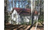Cute Getaway Cabin on 2 Acres. Nice Screened Porch to Enjoy the Outdoors. One Room, Plus Good Size Kitchen and Bathroom. Metal Roof, Fireplace and Air conditioner are 2 year old.