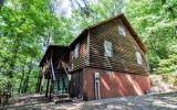 ABSOLUTE PRIVACY IN THE NORTH GEORGIA MOUNTAINS!! Enjoy total seclusion from this lofted cabin surrounded by beautiful hardwoods on 6.5 acres. Main level features tongue and groove walls and cathedral