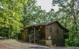 FULLY FURNISHED, TURN-KEY INVESTMENT PROPERTY! 2 bedroom/2 bathroom cabin located in The Last Resort�One level living at its best, indoor hot tub, large bright windows in the living area along with sk