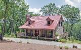 This 3/2.5 Stunning Mountain Cabin sitting at the end of the road on almost five acres has a year round MOUNTAIN VIEW and definitely has the WOW Factor. Seller is an interior decorator and it shows th