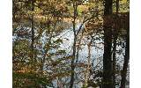 Great location near town, and large waterfront lake lots! Year round lake and mountain views! less than 3 miles from town!