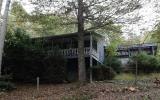 Cozy 2 br/ 2ba home plus 3 rustic cabins, bordering USFS on 2 sides. Main home has partial basement, central gas heat and air, with large covered porch. 2 car garage/workshop. All cabins have small ki