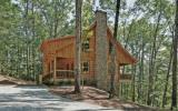 This is a custom real log cabin with wood burning fireplace. Authentic log cabin, metal roof, granite countertops, wood flooring, outdoor fireplace and party area, custom lighting, and wide open space