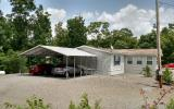 Very Special property not what you would expect to see in a double wide manufactured home, set upon Poured concrete pads to N.C. specifications, in immaculate condition with large RV carport with sewe