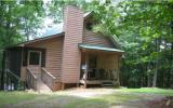 Perfect Vacation Cabin or Year Round Living at an Affordable Price! Close to town with easy access on all paved roads. 3 bedrooms and 2 and 1/2 baths (1 bedroom on each level). Basement is finished wi