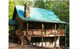 Real log cabin sitting above meandering creek in gated resort community with all paved roads leading to the property. Used primarly as a second home, this pristine cabin features a vaulted ceiling in