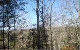 Large wooded parcel ready for your dream cabin! 12.14 acres of heavily...