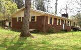 BRICK Ranch on 2.56 ACRES w/STREAM, HugeTrees & 5 Outbuildings,Carport...