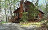 This charming log cabin located minutes from downtown Blue Ridge, a to...